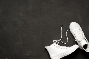 Overhead Shot Of White Sneakers On black Background