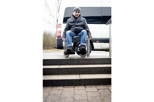 Senior Man In Wheelchair And Stairs