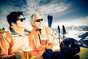 Skiing Senior Couple Having A Break