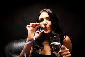 Young Woman With Champagne And Streamer