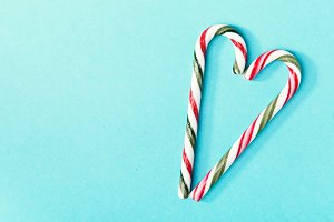 Candy canes composed on blue