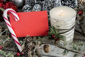 Paper with candle and candy cane