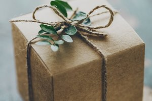 Paper gift box decorated with rope