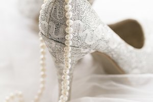 Bridal shoes with pearl necklace