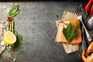 Raw salmon fillet and ingredients