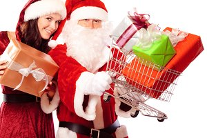 Mr And Mrs Santa Claus Shopping For Gifts