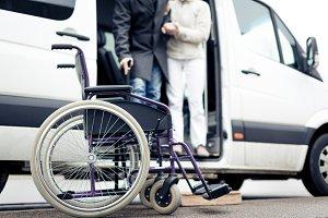 Nurse Helping Senior Man Exit A Van