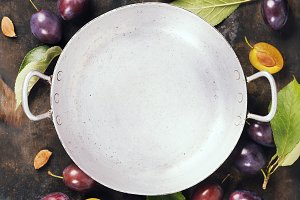 Old bowl and plums
