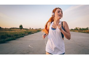 woman running and listening to music on headphones