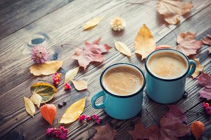 Coffee cups and fallen leaves.