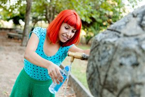 Redhead woman relaxed in a park