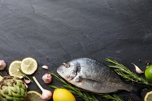 Fresh raw sea bream fish cooking