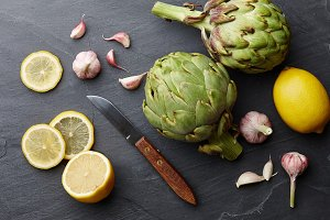 Fresh artichokes cooking with lemons