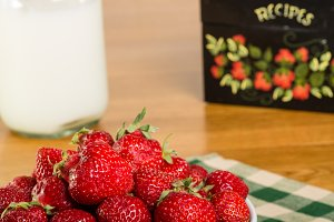 Strawberries with milk bottle
