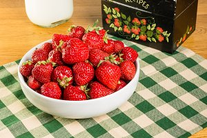 Bowl of strawberries and recipe box