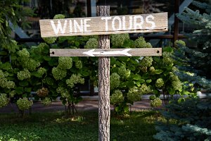 Wooden wine tour left sign