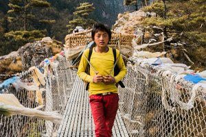 Young Sherpa on a bridge
