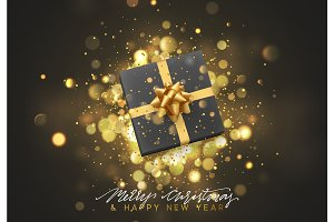 Christmas background with gift box and golden lights bokeh.