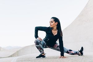 Fit woman doing stretching workout