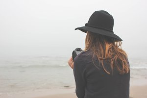 Young Girl with Camera on Beach