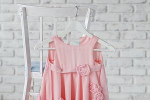 children's dresses hang on hangers