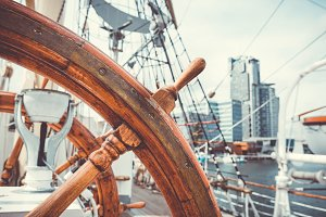 Wooden steering wheel on sail ship
