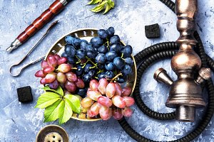 smoking hookah with grapes