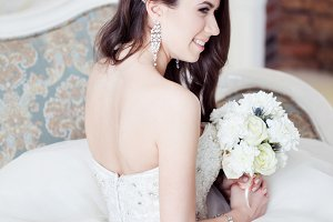 Portrait of beautiful bride. Dress with open back. Wedding decoration