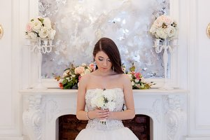 Portrait beautiful bride with a bouquet of flowers. Wedding decoration. Front