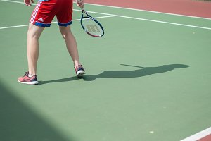 Tennis player shadow on the court