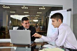 businessmen in his office