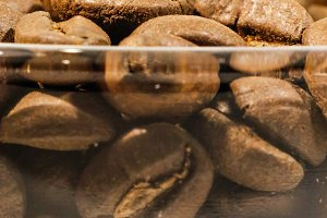 Coffee grains in a glass closeup