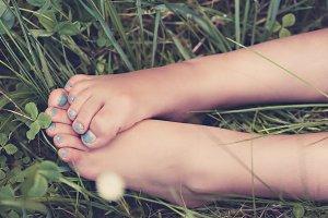 Child's Feet in Meadow