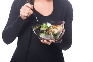 Female eating healthy salad