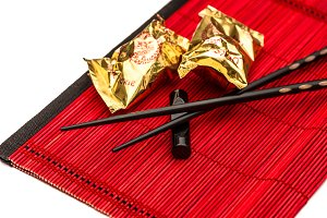 Fortune cookies and black chopsticks