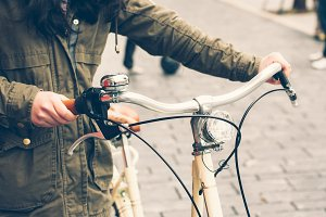 Woman with retro bycicle