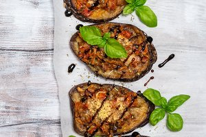 Baked eggplant stuffed with vegetables and cheese