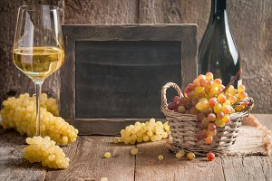 Bottle and glass of wine with grapes