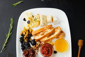 Cheese platter with honey,