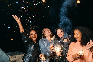 Group of young women with sparklers