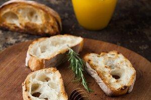 Fresh ciabatta bread with honey