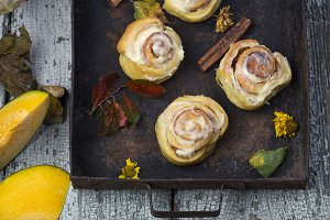 fresh pumpkin cinnabon buns with cinnamon and frosting