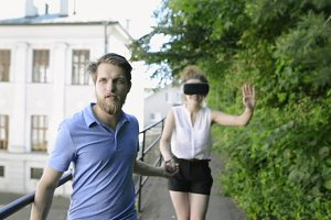 Couple with VR goggles on a walk in town.