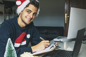 student or worker on the desk at christmas