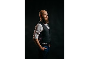portrait of a stylish bearded man on a black background