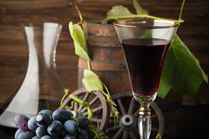 Red grapes, wine glass and decanter