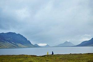 Lake coast with mountain reflection, Iceland