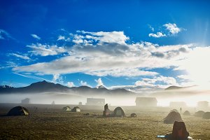 trekking in Iceland. camping with tents near mountain lake