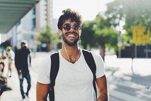 Hipster guy smiling at camera