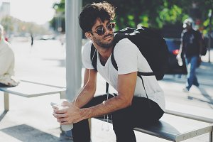 Handsome male is sitting with coffee